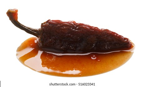Chipotles en Adobo, a whole smoke-dried overripe Jalapeno pepper in seasoning. Clipping path