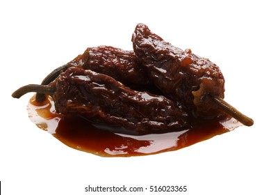 Chipotles en Adobo, a whole smoke-dried overripe Jalapeno peppers in seasoning. Clipping path