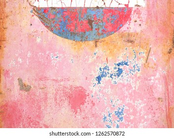 Chipped, cracked paint peeling off of a metal sign in bright colors of pink, blue, white and rust.