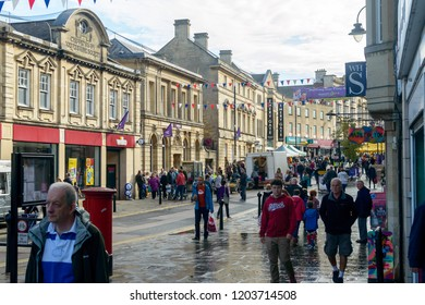 Chippenham, England - Oct 13, 2018: Looking Down High Street Chippenham, busy time - crowd on sat, open market, shallow depth of field horizontal photography