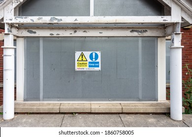 Chippenham Wiltshire UK  June 29, 2020, A window of an empty building  protected and secured by steel screens with safety and warning notices