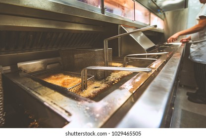 Chips cooking in Fish and Chip shop
