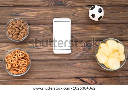 chips crackers snacks smartphone soccer ball stock photo edit now