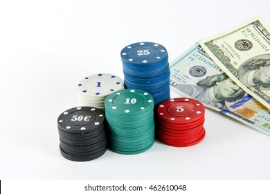 The chips of different values for casino games and $ 100 banknotes