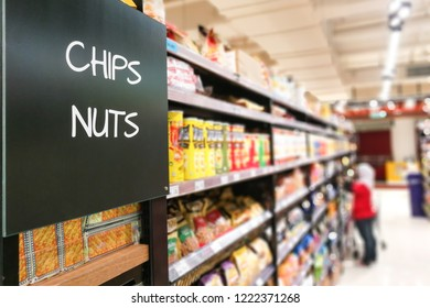 Chips and Nuts signage grocery categoy aisle at supermarket