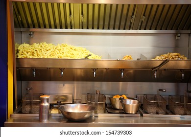 Chips production at a French fries stand.
