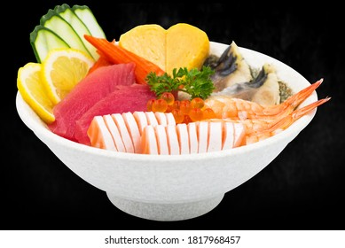 chirashi japanese food sashimi tuna donburi. A dish originating in Japan on black background. mixes sashimi donburi.