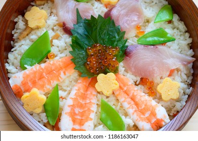 Chirashi sushi is a type of Japanese dish made with sushi rice topped with the assortment of sashimi and colorful garnishes.