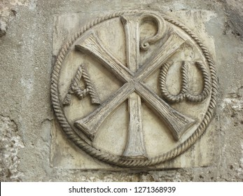 Chi-Rho or sigla the letters X and P representing the first letters of the title Christos plus alfa and omega