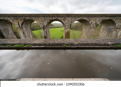 Chirk Aqueduct carries the Llangollen Canal across the Ceiriog Valley near Chirk, on the England-Wales border, spanning the two countries.