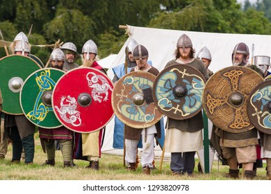 Chirk Wales UK - September 2 2018: Medieval re-enactors dressed in armour and costumes of the 12th century equipped with weapons re-enacting combat of the period