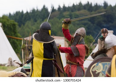 Chirk Wales UK - September 2 2018: Medieval re-enactors dressed in armour and costumes of the 12th century equipped with swords and armour re-enacting combat of the period