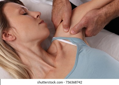 Chiropractic back adjustment. Osteopathy, Acupressure. Female patient suffering from back pain and physical therapist