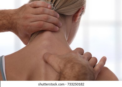 Chiropractic back adjustment. Osteopathy, Acupressure,Sport Injury Rehabilitation concept. Female patient suffering from back pain and physical therapist