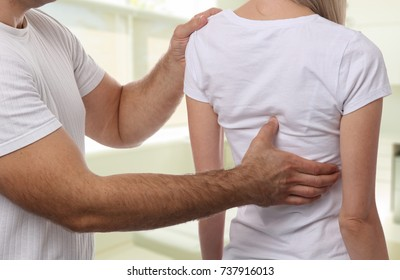 Chiropractic back adjustment. Osteopathy, Alternative medicine, pain relief concept. Physiotherapy, sport injury rehabilitation