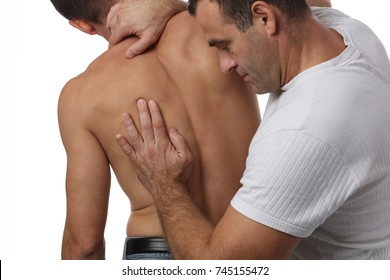 Chiropractic back adjustment. Osteopathy, Alternative medicine, pain relief concept. Physiotherapy, sport injury rehabilitation isolated on white.