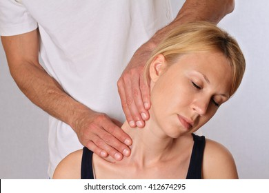 Chiropractic, osteopathy, dorsal manipulation. Therapist  doing healing treatment on woman's neck . Alternative medicine, pain relief concept