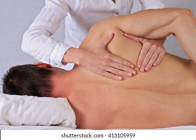 Chiropractic, osteopathy, dorsal manipulation. Therapist  doing healing treatment on man's back . Alternative medicine, pain relief concept