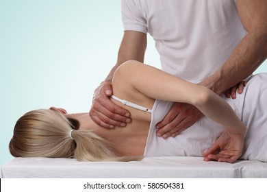 Chiropractic, osteopathy, dorsal manipulation. Therapist doing healing treatment on women's back . Alternative medicine, pain relief concept isolated on white.