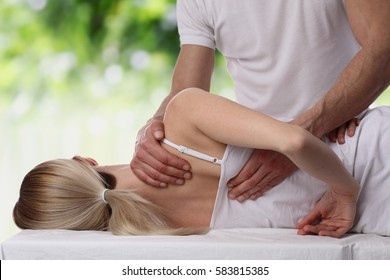 Chiropractic, osteopathy, dorsal manipulation. Therapist doing healing treatment on women's back . Alternative medicine, pain relief concept.