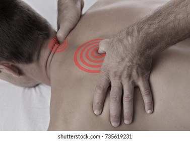 Chiropractic, osteopathy, manual therapy, acupressure. Therapist doing healing treatment on man's back. Alternative medicine, pain relief concept