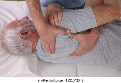 Chiropractic / Osteopathy treatment, Back pain relief. Physiotherapy for senior male patient, sport injury recovery , Kinesiology