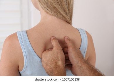 Chiropractic treatment, Back pain relief. Physiotherapy / Kinesiology for female patient, sport injury recovery