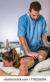 Chiropractic treatment. Chiropractor working with female athlete