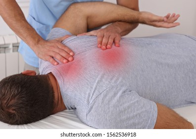 Chiropractic treatment. Shiatsu massage, Back Pain trigger points. Physiotherapy for male patient, Sport Injury Recovery