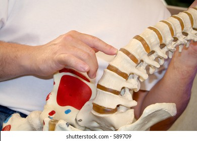 chiropractor pointing at spine