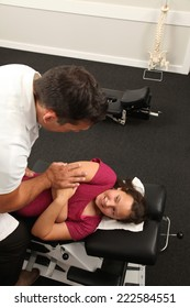 A Chiropractor treating a young girl