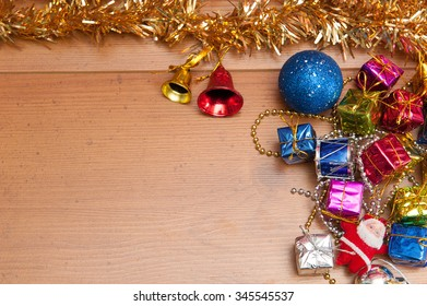 Chirstmas card and gift on the wooden floor