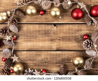chirstmas frame with red and gold balls and pine cones