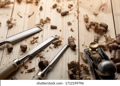 Chisel and small block plane with wood shavings. Carpenter cabinet maker hand tools on the workbench.