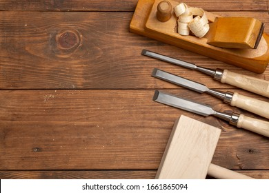 Chisel for woodworking on a workbench. Carpenter cabinet maker hand tools on the workbench.