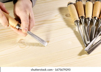 Chisels. Assortment of chisel of wood for carpentry. Hand holding chisel.