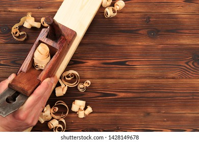 chisels plane and sawdust on a wooden table - Image