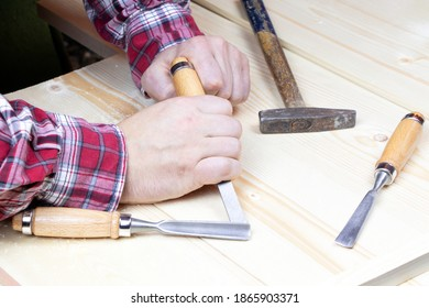 Chisels. Work of carpenter. Handyman with tools.Assortment of chisel of wood for carpentry. Hand holding chisel
