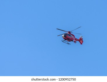 CHISINAU, MOLDOVA- APRIL 29, 2018: The smurt helicopter flying against the background, medical aid of government of romania