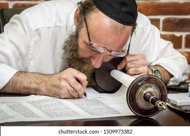 """CHISINAU, MOLDOVA. August 25, 2019. A traditional Jewish Torah scribe """"sofer stam"""" working on a new Torah script for the historical """"Wooden"""" synagogue in the downtown Kishinev."""