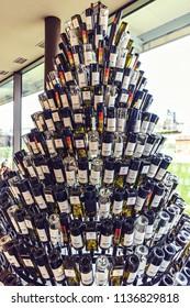 CHISINAU, MOLDOVA - DECEMBER 16, 2017: Wide shot of Christmas wine bottles tree inside Mimi Castle