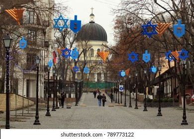 Chisinau, Moldova - December 17, 2017: Pedestrian street of Eugen Doga, a popular place in central Chisinau among locals and tourists, decorated during Hanukkah holidays.