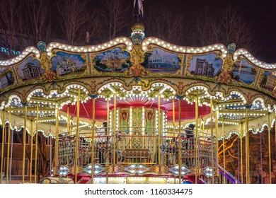 CHISINAU, MOLDOVA - DECEMBER 25, 2017: Christmas carousel in center of the city at night. Lights glowing.