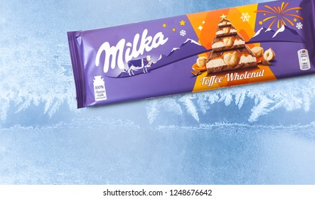 CHISINAU, MOLDOVA - DECEMBER 4, 2018: Bar of Milka chocolate isolated on froze background. Milka is a brand of chocolate confection which originated in Switzerland in 1901.