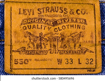Chisinau, Moldova February 10, 2017: Close up of the LEVI'S leather label on the blue jeans. Retro style toned image. LEVI'S is a brand name of Levi Strauss and Co, founded in 1853