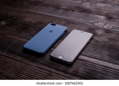Chisinau, Moldova - January 23, 2018: new black iPhone with dark blue case on brown wooden table