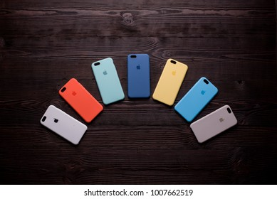 Chisinau, Moldova - January 23, 2018: seven different-colored cases are beautifully stacked on wooden table