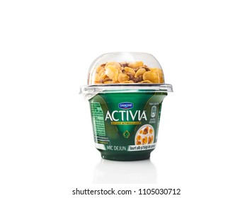 Chisinau, Moldova - June 04, 2018: Danone is a multinational food-products corporation based in Paris. Danone Activia Breakfast Sweetened Yogurt with Wheat & Corn Flakes and Live Cultures