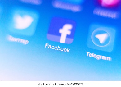 Chisinau, Moldova - June 10, 2017: Macro photo facebook sign icon and search bar on Mobile Phone, Facebook is a social networking service, owned and operated by Facebook, Inc.
