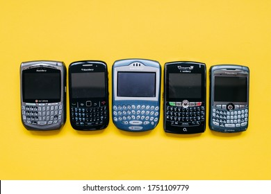 Chisinau, Moldova - June 2, 2020: collection of old BlackBerry mobile phones on yellow background.
